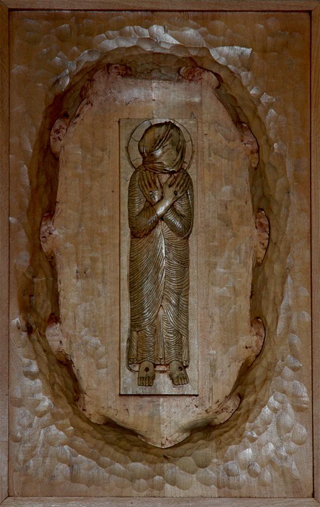 Quatorzième station : Jésus est mis au tombeau. Gravure sur bois, église Notre-Dame du Travail, Paris.